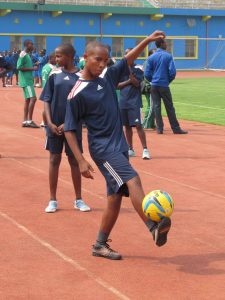 A boy from Umutara practicing his skills before the match.