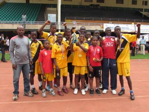 Nyabihu team with their football medals, the Athletics cup and athletics medals.