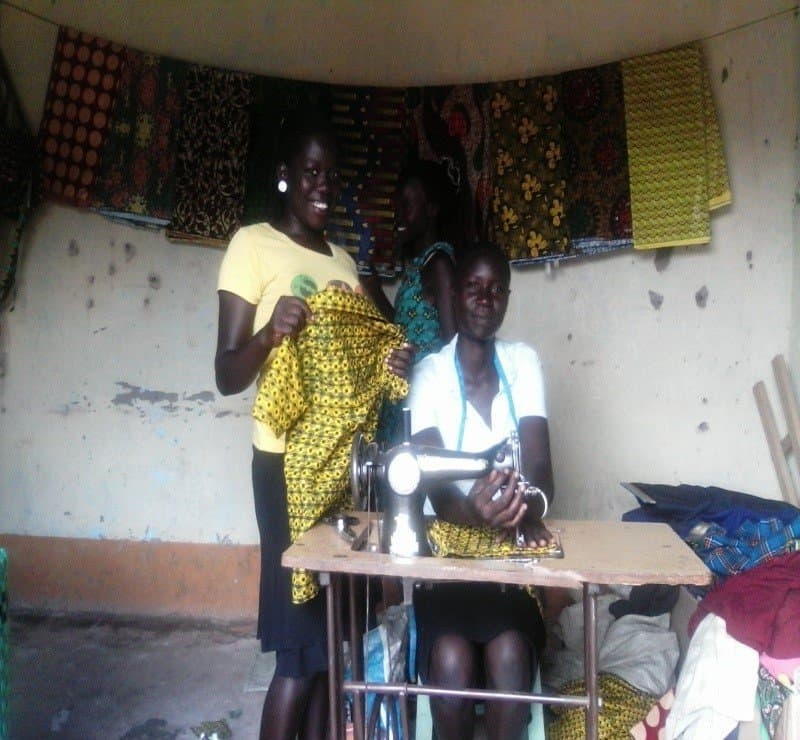 Miremba today, with her sewing machine